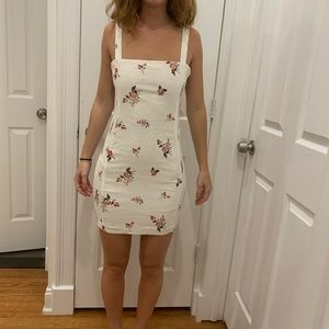 White dress with red flowers